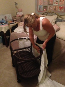 Sophie and Mommy putting together her bassinet!